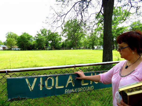 Sally Liuzzo-Prado stands in a park dedicated to her mother, Viola Liuzzo, a civil rights activist who was killed in Alabama.