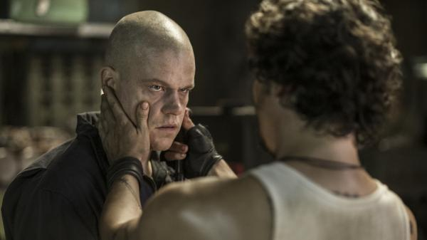 Wagner Maura, as someone named Spider, handles Max (Matt Damon) in <em>Elysium</em>.