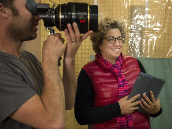 Jenji Kohan, seen here on the set of <em>Orange Is the New Black</em>, began her writing career on <em>The Fresh Prince of Bel-Air</em>.