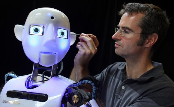 "No matter what face you put on it, science is a powerful tool. Here, engineer Marcus Hold works on a nearly completed <a href=""http://www.robothespian.co.uk/"">RoboThespian</a>. Marvels of modern science, these fully interactive and multilingual humanoid robots are increasingly being sold to academic research groups."