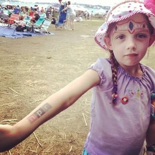 This little lady is our biggest little fan. She's come by every day to say hi and her mom says she listens to NPR everyday! #nprtattoo #newportfolk