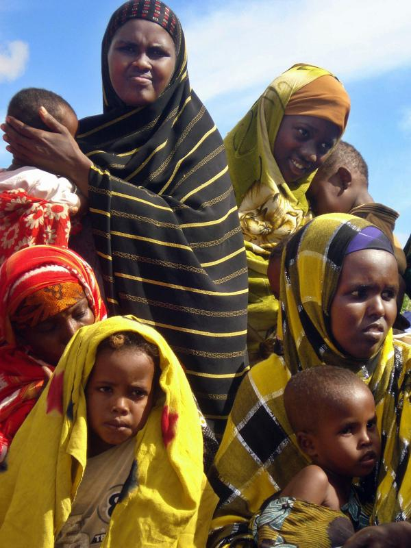 Women wait with their children outside a clinic run by Doctors Without Borders south of Mogadishu. In many parts of southern Somalia, the medical charity is the only provider of basic health care.
