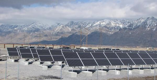 View of mountains and new solar panels at Bear River Migratory Bird Refuge in Utah. The Refuge continues to pursue sustainable electricity production with the addition of the solar panels near the James V. Hansen Wildlife Education Center. (Jason St. Sauver/USFWS via Flickr)
