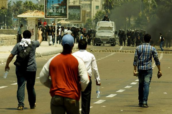 Supporters of ousted President Morsi clash with security forces in Alexandria, Egypt on Wednesday. Egypt's interim Prime Minister Hazem Beblawi defended the government's actions, saying the crackdown was necessary to restore security and he also praised the police for self-restraint.
