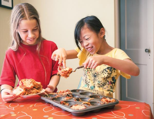 "Kids make ""Little Lasagnas"" from the cookbook ""Chop Chop: The Kids Guide to Cooking Real Food With Your Family."" (Carl Tremblay/Simon & Schuster)"