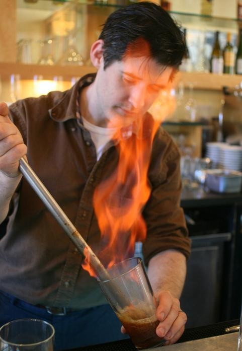 Flip back in time: Chef David Arnold mixes up a drink with a blazing-hot metal rod, a method similar to how bartenders used to make the flip cocktails that were wildly popular in colonial New England.
