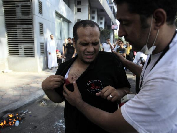 A man in Cairo who said he had been wounded by a rubber bullet Friday gets help.
