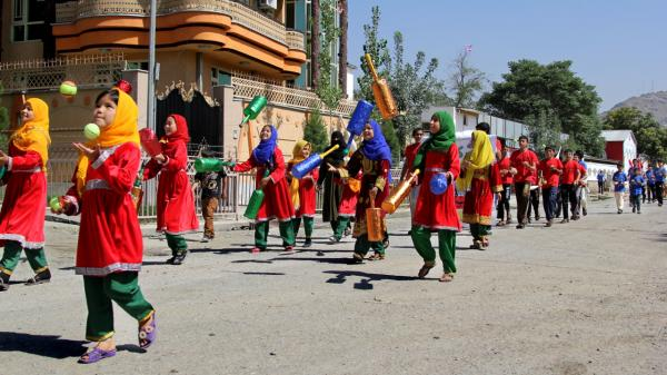 Students at the Afghan Mobile Mini Circus for Children participate in the juggling parade on the streets of Kabul before Afghanistan's eighth annual national juggling championship last week.