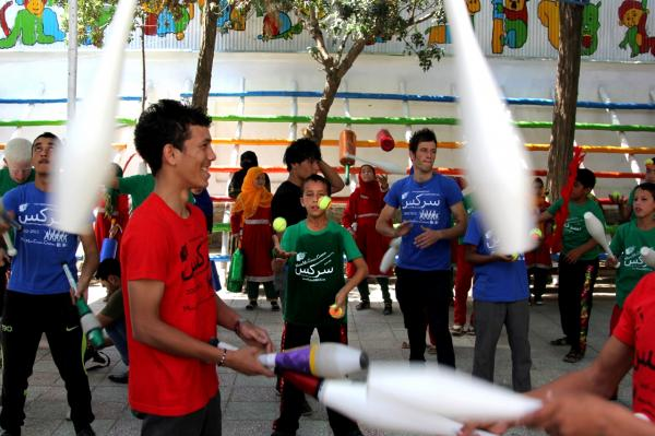 Students at the decade-old Afghan Mobile Mini Circus for Children warm up before the juggling championship in Kabul.