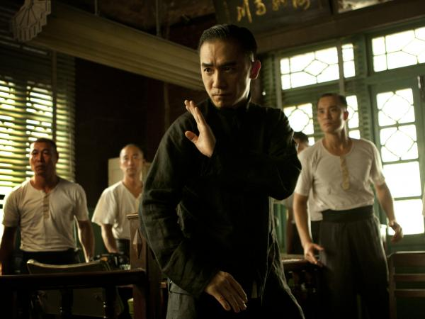 Tony Leung (center) fends off challengers as Wing Chun kung fu master Ip Man in Wong Kar Wai's <em>The Grandmaster</em>.