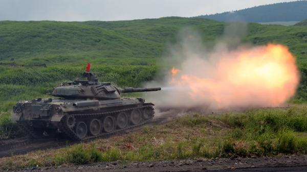 A Japanese tank fires during an annual training exercise at the foot of Mount Fuji in on Tuesday.