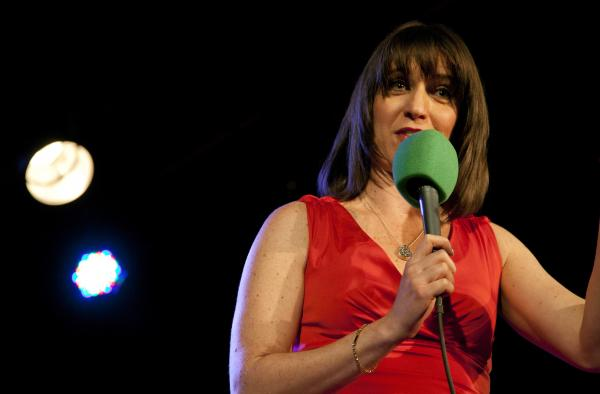 Host Ophira Eisenberg warms up the crowd with some of her comedy routine during a live taping of <em>Ask Me Another</em> at The Bell House in Brooklyn, NY.