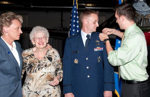Air Force Major Jeff Mueller, second from right, is pictured with his mother, grandmother and partner Eric Gustafson, at Mueller's promotion ceremony to Major at the Peterson Air Force Base Museum in Colorado Springs, September 26, 2011. (Courtesy of Jeff Mueller)