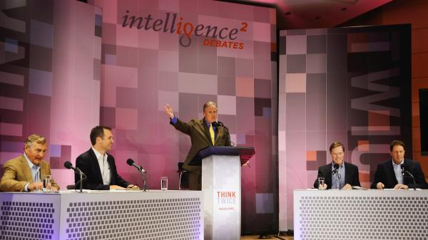 John Donvan moderates an <em>Intelligence Squared U.S.</em> debate on Syria at the Aspen Institute in Aspen, Colo. Those debating are: (from left) Graham Allison, Richard Falkenrath, Nicholas Burns and Nigel Sheinwald.