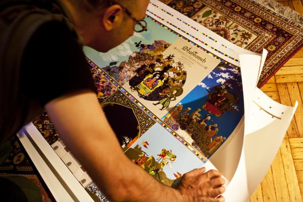 Rahmanian reviews proofs of the book at his Brooklyn, N.Y., studio. His illustrations combine imagery drawn from traditional Persian art spanning the 14th through 19th centuries.