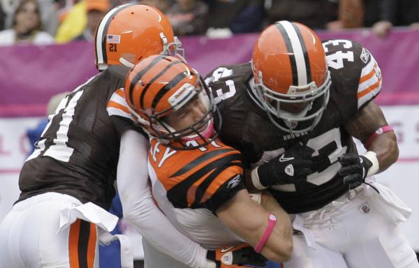 This hit, Oct. 3, 2010, left the Cincinnati Bengals' Jordan Shipley (center) with a concussion, and the Cleveland Browns' T.J. Ward (right) with a fine. (Amy Sancetta/AP)