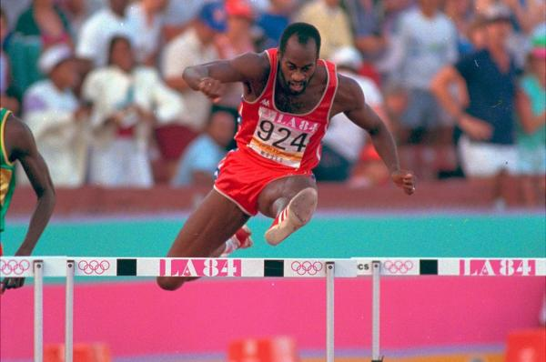 Edwin Moses jumps a hurdle on his way to winning the gold medal in the 400-meter hurdles in Los Angeles, August 5, 1984. (AP)