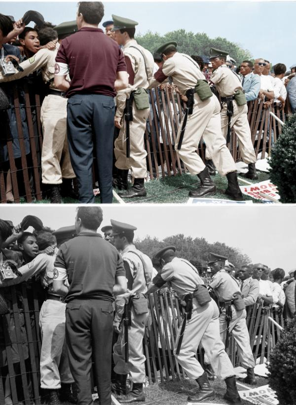 "A storm fence guarded by police. Colorized by <a href=""https://www.facebook.com/imbuedwithhues"">Patty Allison</a>."