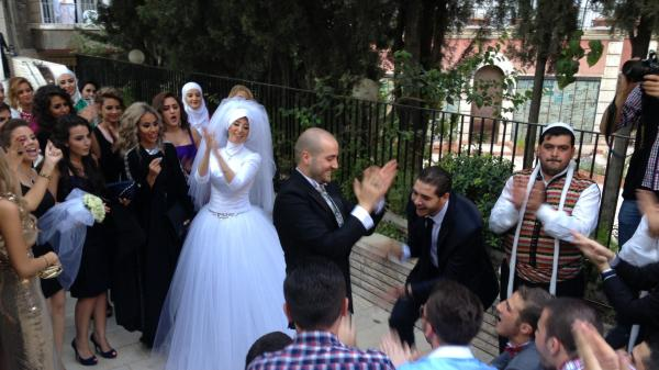 The bride, groom and wedding party celebrate Thursday in the Syrian capital, Damascus. It was a brief respite for residents of the neighborhood who were expecting U.S.- or NATO-led airstrikes.
