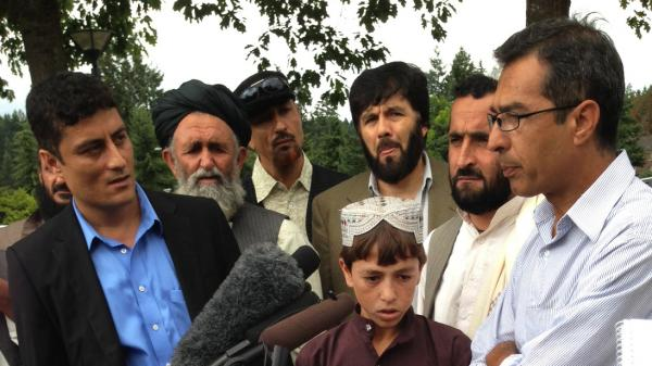 Sadiqullah (center), who was shot by Staff Sgt. Robert Bales and was a witness in the trial, stands with some of the Afghan civilians who traveled from Kandahar to the U.S. for Bales' trial. Translator Ahmad Shafi is at left, in the blue shirt.