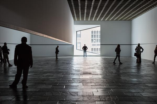 Visitors explore Robert Irwin's <em>Scrim Veil--Black Rectangle--Natural Light</em> during its 2013 reprise at the Whitney Museum of American Art.