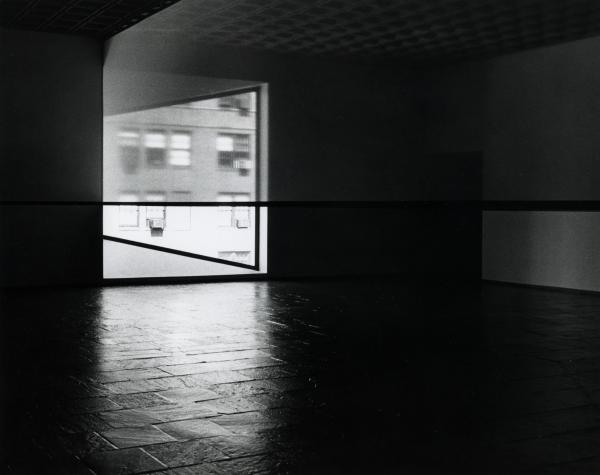 A photo from the 1977 debut of Robert Irwin's <em>Scrim Veil--Black Rectangle--Natural Light</em> at the Whitney Museum of American Art.