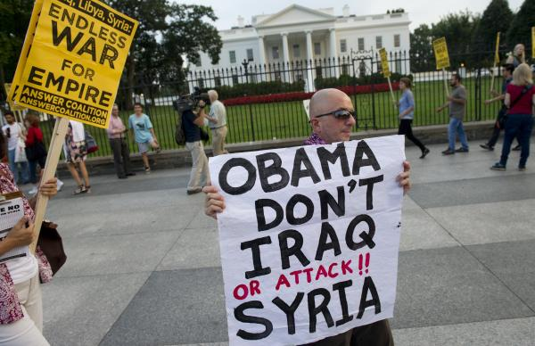 Demonstrators march in protest during a rally against a possible U.S. attack on Syria.