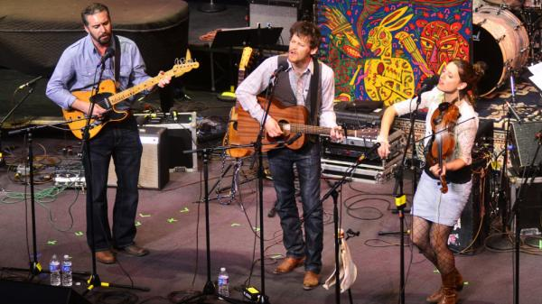 From left, Greg Glassman, David Wax and Suz Slezak perform on <em>Mountain Stage</em>.
