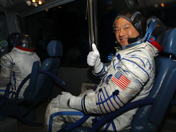 American astronaut Leroy Chiao gives a thumbs up during the ride from a suit-up facility in Kazakhstan in 2004. The mission took Chiao to the International Space Station and was his last trip into space before retiring in 2005.