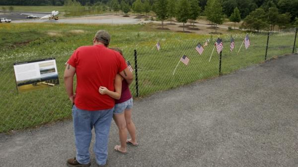 Lloyd Smith, left, and Laura Sprankle of Hagerstown, Md., visit the overlook at the temporary Flight 93 memorial in Shanksville, Pa., Monday, Aug. 1, 2011.