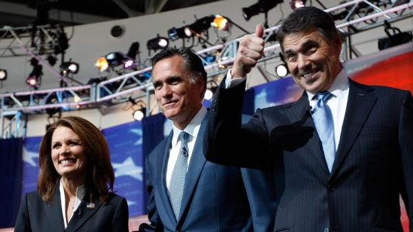 Texas Gov. Rick Perry (right) takes the stage with Mitt Romney and Rep. Michele Bachmann before Wednesday night's GOP presidential debate at the Ronald Reagan Presidential Library in Simi Valley,  Calif.