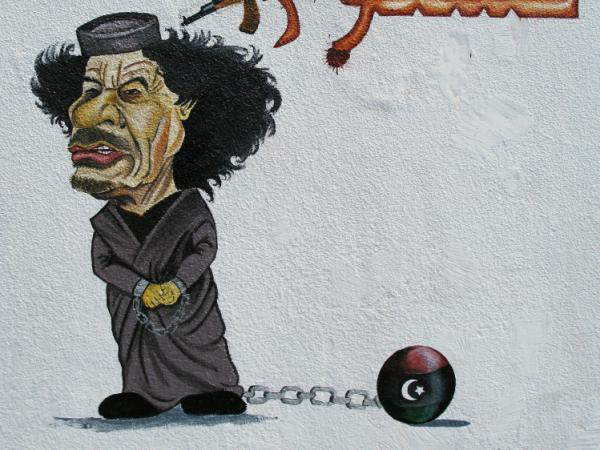 Caricatures of the ousted Gadhafi have sprung up all over Tripoli. This image of Gadhafi in chains is on a wall in the capital's Fashlum neighborhood.