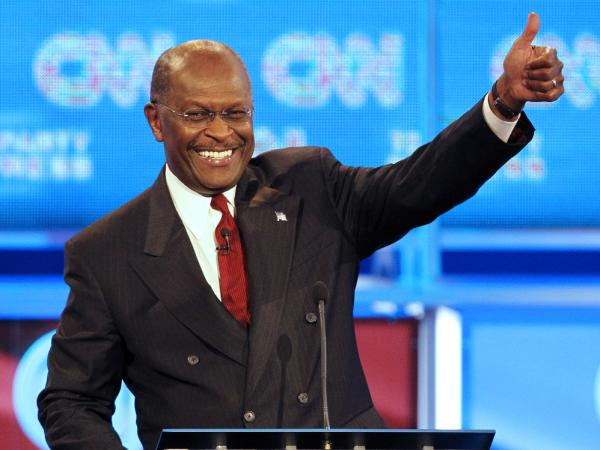Republican presidential candidate businessman Herman Cain gives the thumbs up during a break in a Republican presidential debate Monday, Sept. 12, 2011, in Tampa, Fla. (AP Photo/Mike Carlson)