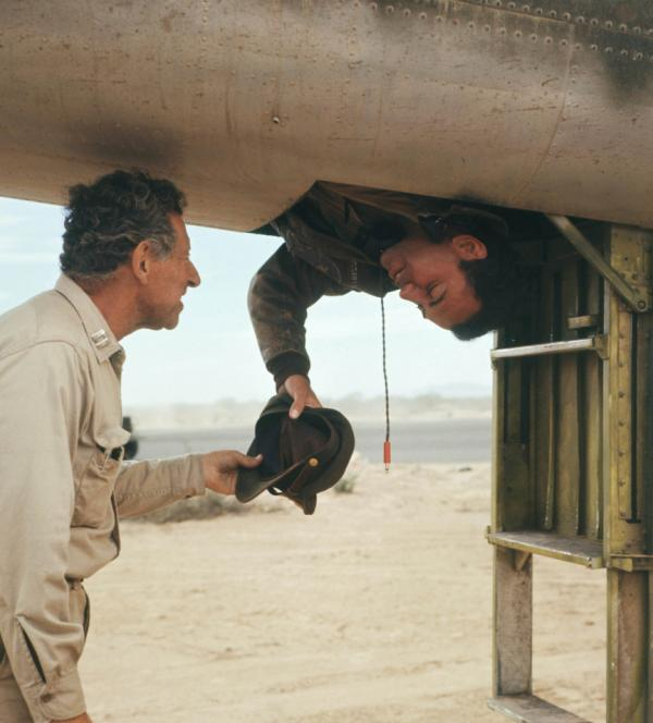 "<p><strong></strong> In the 1970 film adaptation of Joseph Heller's novel, physician ""Doc"" Daneeka (left), played by Jack Gilford, explains the Catch-22 paradox to Capt. John Yossarian (Alan Arkin): ""Anyone who wants to get out of combat isn't really crazy,"" Daneeka says.</p>"