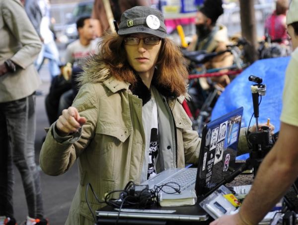 <p>Colin Laws mans an Internet live-stream station in Zuccotti Park near Wall Street. He says he was inspired in part to join the protests by Hero Vincent, another member of the group's Livestream team.</p>