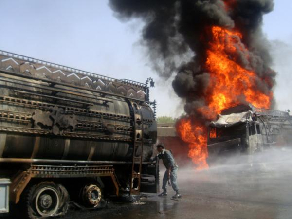 <p>A tanker bringing fuel to U.S. and NATO forces burns after being attacked by militants in Afghanistan's Logar province in August. Military officials say fuel convoys are a significant vulnerability for U.S. forces.</p>