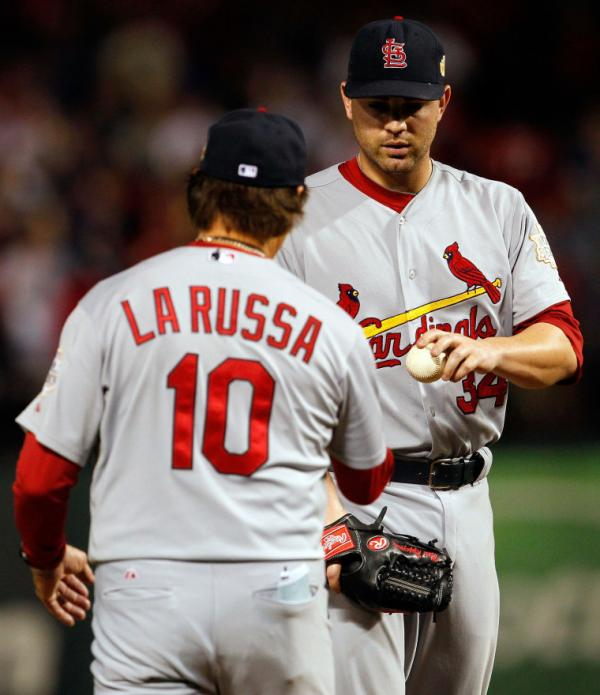 <p>A little too late: Pitcher Marc Rzepczynski of the St. Louis Cardinals is removed by manager Tony La Russa in the eighth inning during Game Five of the MLB World Series against the Texas Rangers. Earlier in the inning, Rzepczynski was mistakenly left in the game because of a miscommunication between LaRussa and his bullpen. And the pitcher gave up the game-winning hit.</p>