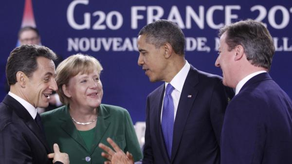 President Obama speaks with (from left) French President Nicolas Sarkozy, German Chancellor Angela Merkel and British Prime Minister David Cameron at the G-20 summit in Cannes, France, on Thursday. The talks were dominated by Greece's financial woes.