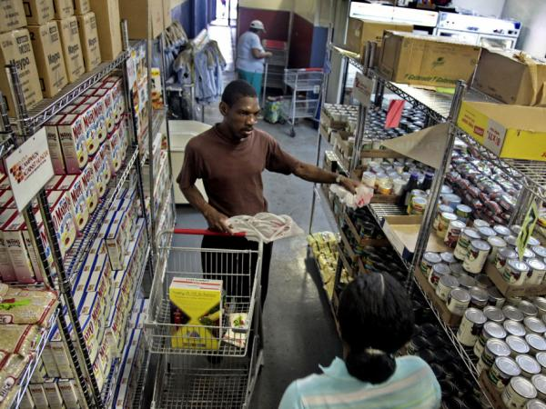 Joseph Byrd, unemployed and living on disability, prepares to pick up groceries at the Bed-Stuy Campaign Against Hunger food pantry in Brooklyn, N.Y., in 2010. The new experimental poverty measure takes into account cost of living associated with geographic differences.