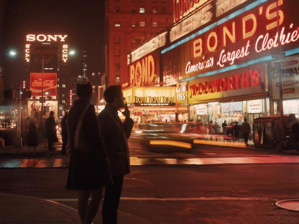 Two pedestrians stand on Broadway at West 44th Street in New York's Times Square on a November night in 1976. In his new memoir, critic James Wolcott writes about his life in 1970s New York.