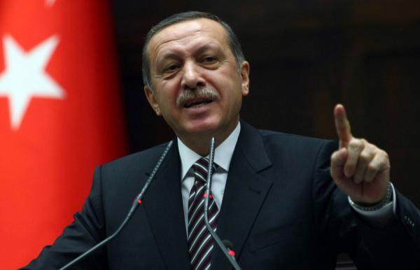 "Turkey's Prime Minister Recep Tayyip Erdogan warned Syrian President Bashar Assad that his brutal crackdown on opponents threatens to place him on a list of leaders who ""feed on blood."""