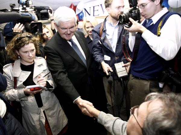 Republican presidential candidate Newt Gingrich greets a supporter at a kickoff party for the opening of a campaign office in Manchester, N.H., on Nov. 11.