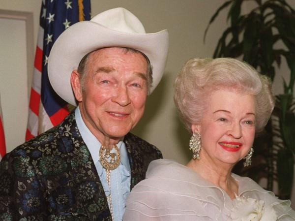 Actors Roy Rogers and Dale Evans are shown in this photo, as Roy sports a bolo tie honoring his horse, Trigger.