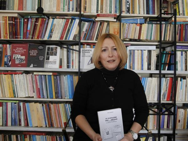Historian and cookbook author Eleni Nikolaidou with her book <em>Starvation Recipes</em>. Recession-hit Greeks are fascinated with the book's World War II-era survival tips and recipes.