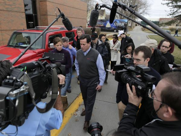 Rick Santorum with news media after a campaign stop in Indianola, Iowa.