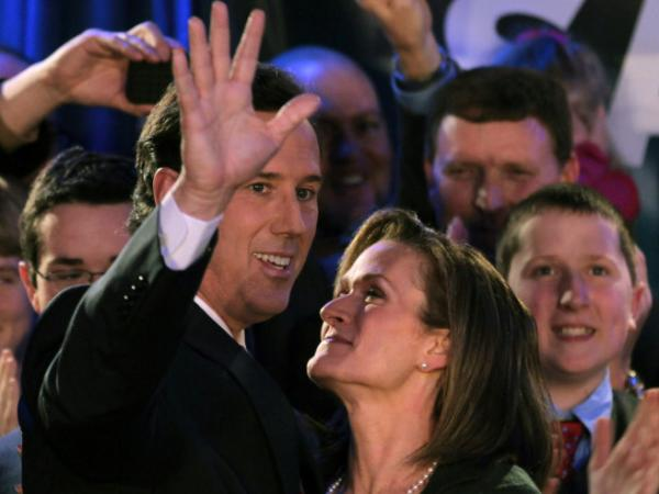Rick Santorum and his wife, Karen, attend a rally Tuesday night in Johnston, Iowa.