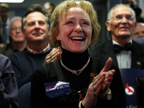 "Susan Carroll of Atkinson, N.H., reacts to news of a Santorum lead at a caucus-watching party at Santorum's New Hampshire campaign headquarters in Bedford. Carroll is the Santorum campaign's Tea Party liaison for the state and describes herself as the owner of a small business that offers ""artistic services."""