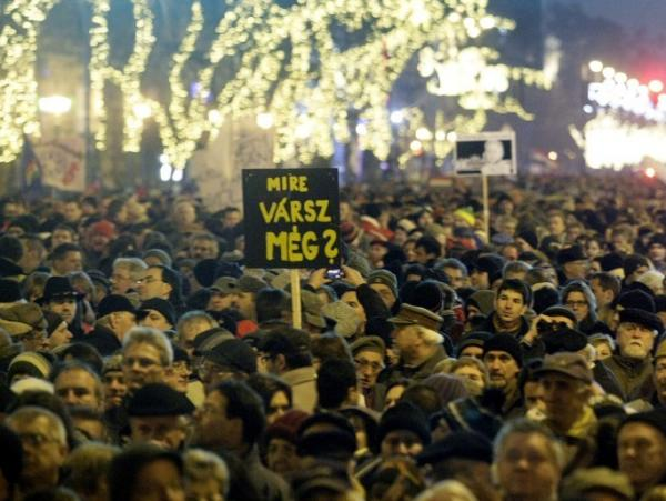 People gather to protest against Hungary's new constitution outside the Opera House in Budapest on Jan. 2. Critics say the document curbs democracy.