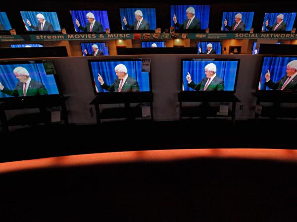 Dozens of televisions display a political advertisement with the image of GOP presidential hopeful Newt Gingrich at a store in Urbandale, Iowa, on Dec. 27. Republican candidates and their superPACs have spent millions on television and radio ads.