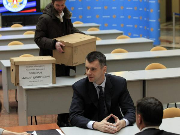 Russian billionaire Mikhail Prokhorov speaks to election officials as he submits documents in the Central Election Commission to officially register as a candidate in March's presidential election.